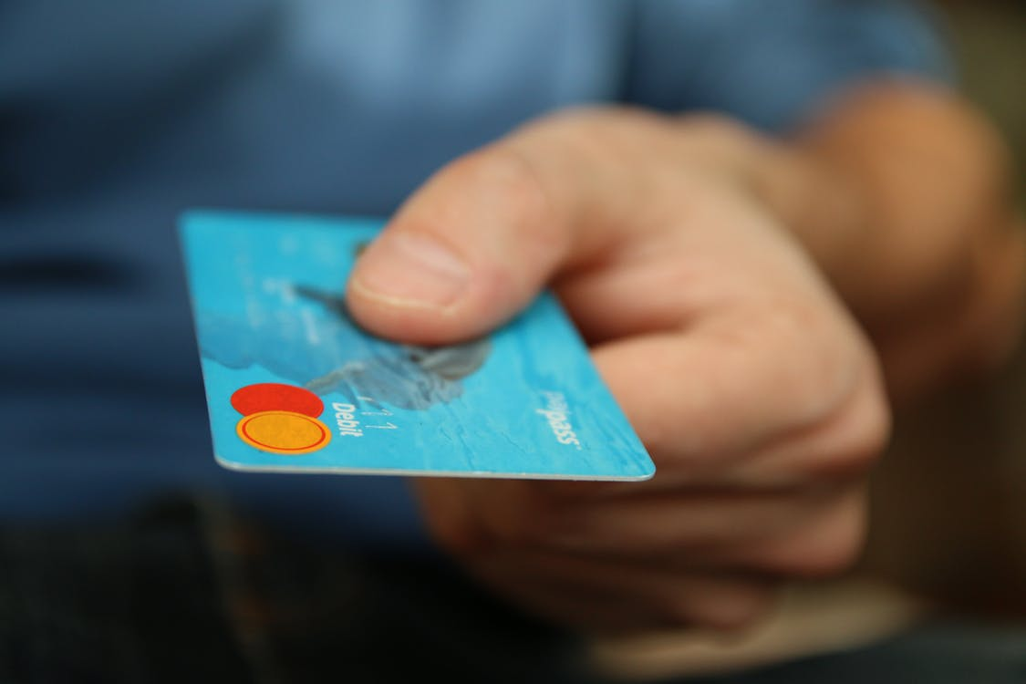 How to Pay Off Credit Card Debt: Step-By-Step Guide